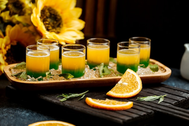 Glasses of ombre juice with mint and orange