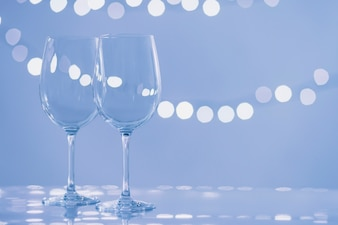 Glasses on light blue background