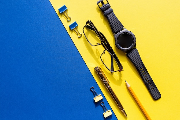 Glasses, smart watch and office supplies