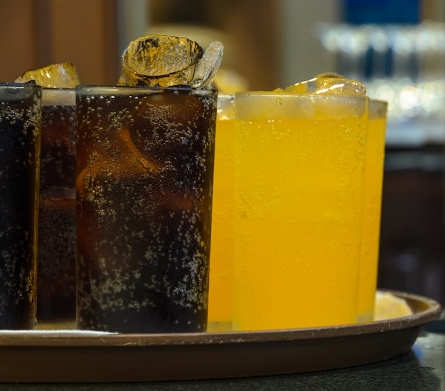 Glasses of soft drink with ice