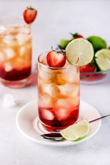 Glasses of strawberries  ice tea