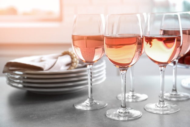 Glasses of strawberry wine on table