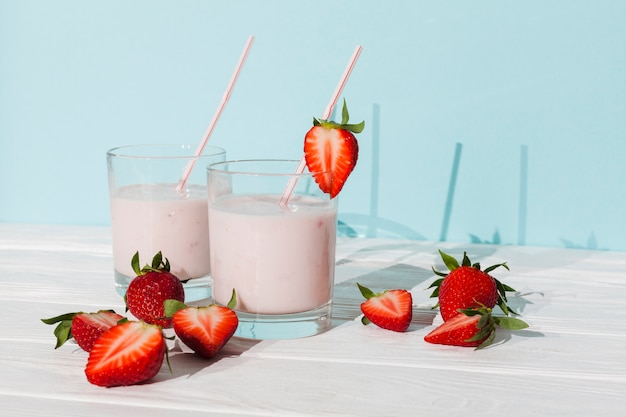 Glasses of strawberry yogurt with berries