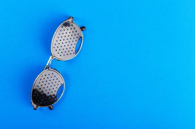Glasses trainers. black pinhole glasses. medical concept. top view