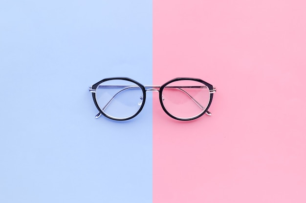 Glasses on two color pastel background.holiday concept idea