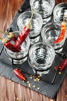 Glasses of vodka with hot chili peppers