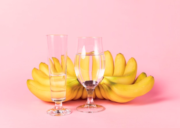 Glasses of water and bunch of bananas