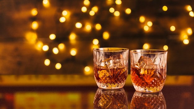 Glasses of whiskey with bokeh effect