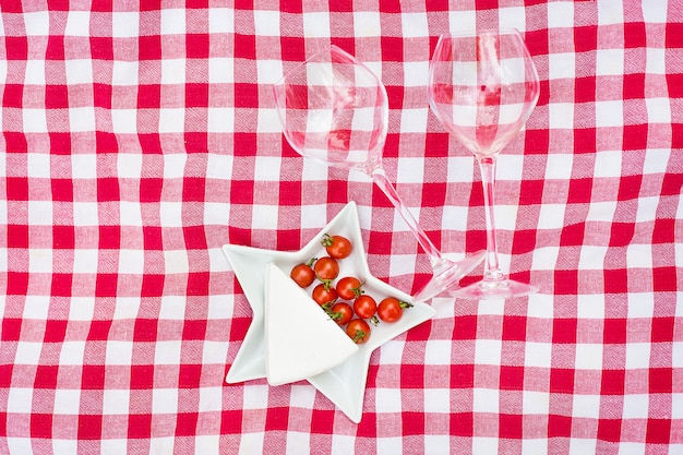 Glasses of wine with food on table