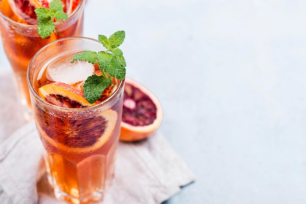 Glasses with aromatic fruit ice tea and copy-space