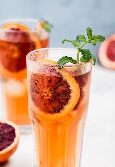 Glasses with aromatic fruit ice tea