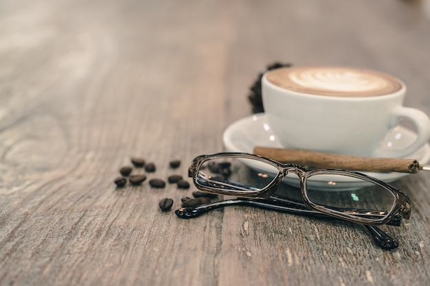 Glasses with coffee cup on table