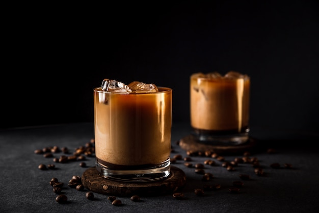 Glasses with cold iced coffee with milk