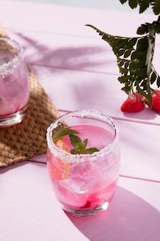Glasses with cold strawberry drink and mint