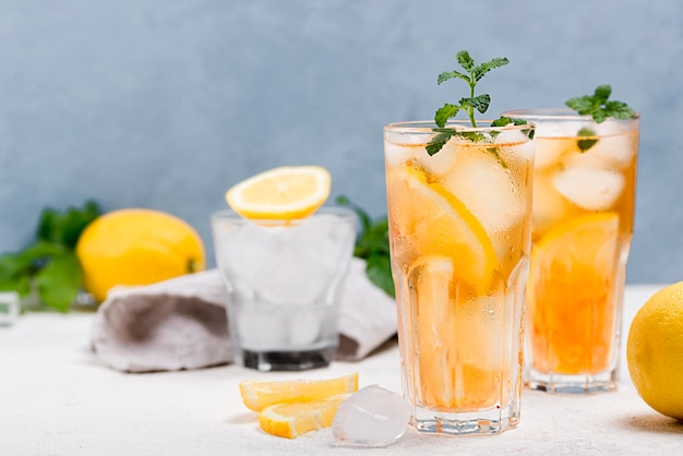 Glasses with fresh ice tea on table