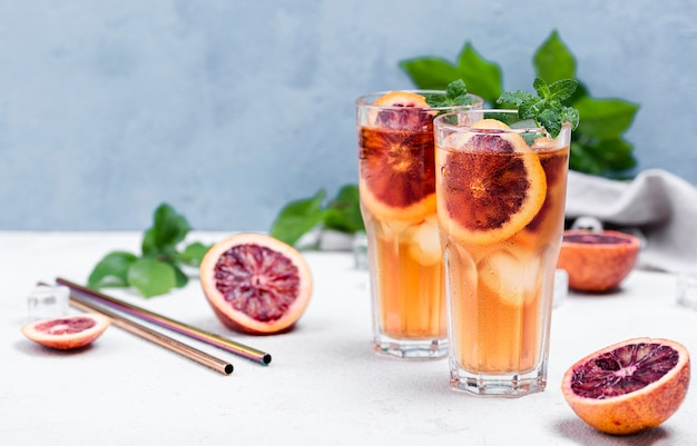 Glasses with fruit ice tea on table