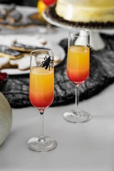 Glasses with halloween juice on table
