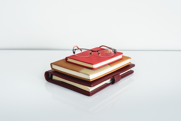 Glasses with notebook on a table