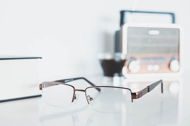 Glasses with radio, book and coffee
