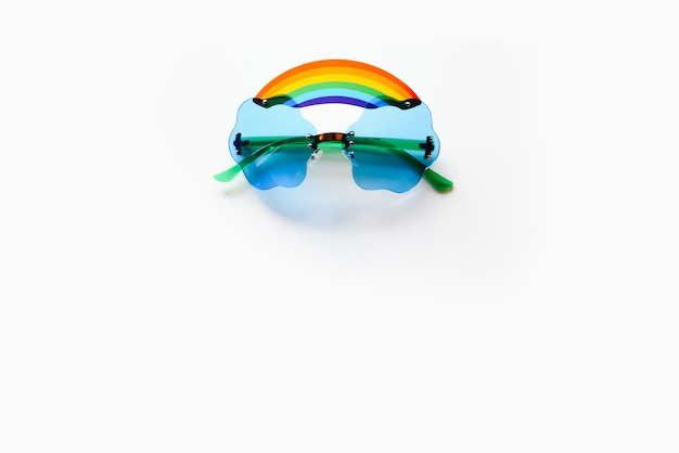 Glasses with rainbow on white