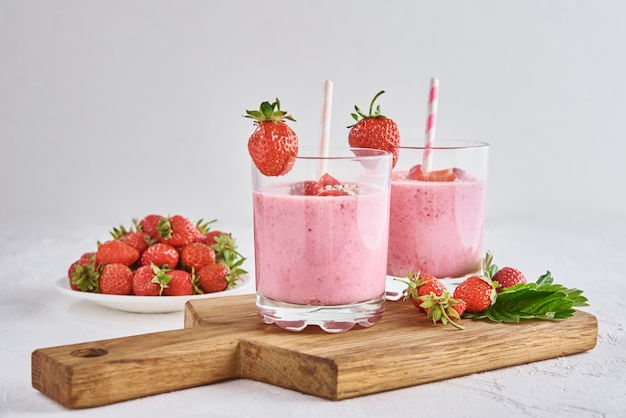 Glasses with strawberry shake and fresh berries