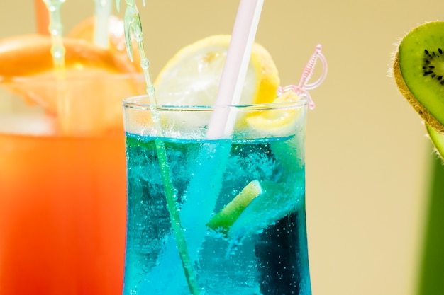 Glasses with various colorful cocktails