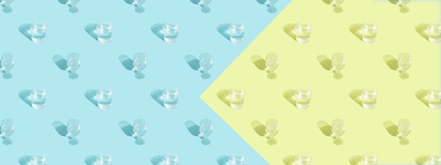 Glasses with water and shadow pattern on blue background banner format