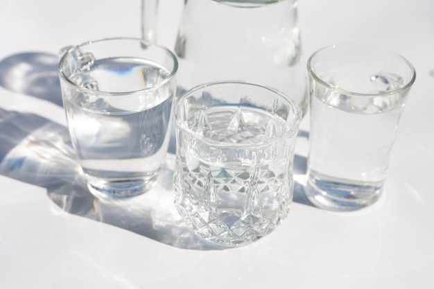 Glasses with water on white surface