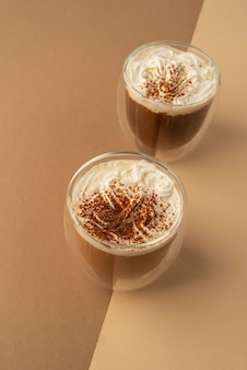Glasses with whipped cream and coffee