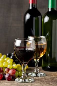 Glasses with white wine beside organic grapes
