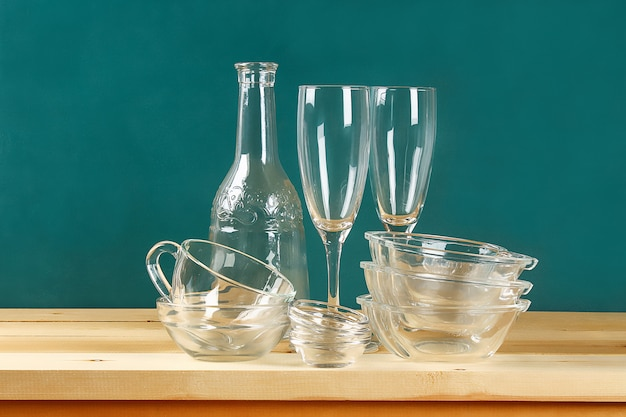 Glassware. glass plates, cups, bowls. dishes on shelf. kitchenware.