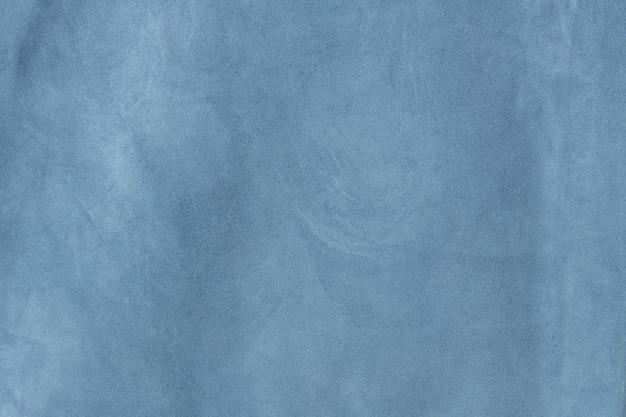 光沢のあるブルーのテクスチャードスエードレザーの表面の背景