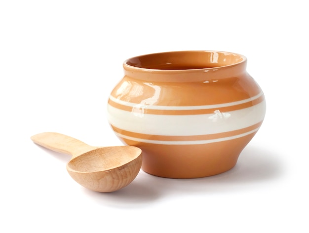 Glazed ceramic pot for cooking with wooden spoon