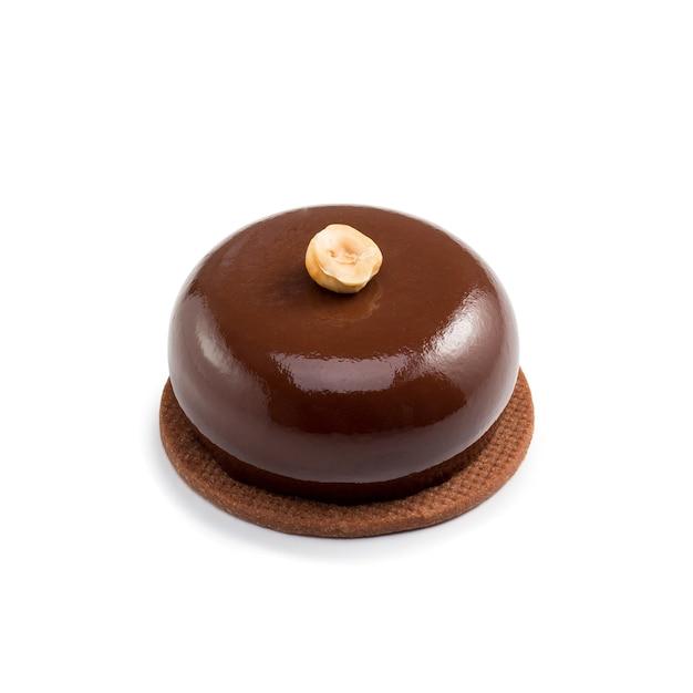 Glazed chocolate mini tart with cream isolated, close-up
