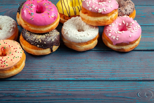 Glazed donuts on wooden