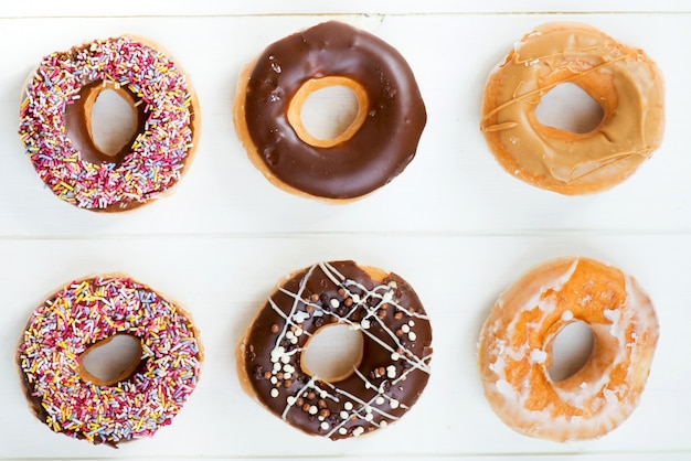 Delicious donuts with colourful sprinkles Photo | Free Download