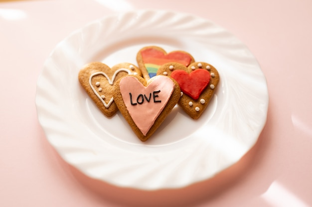 Glazed heart shaped cookies. baking with love for valentine's day, love and diversity concept.