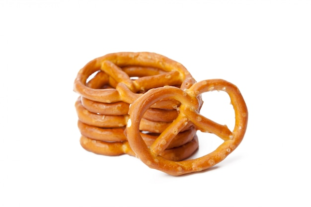 Glazed and salted pretzels isolated on white