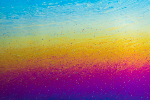 Gleaming wavy purple blue and yellow abstract background