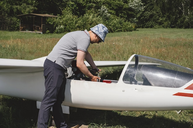 Glider pilot near the plane in soaring club extreme sport