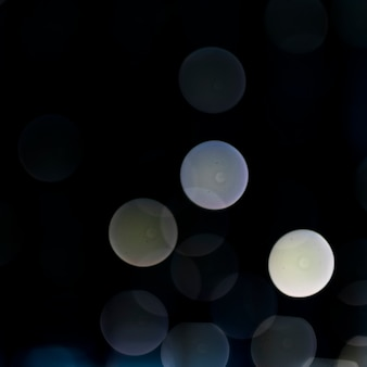 Glitter bokeh dark background