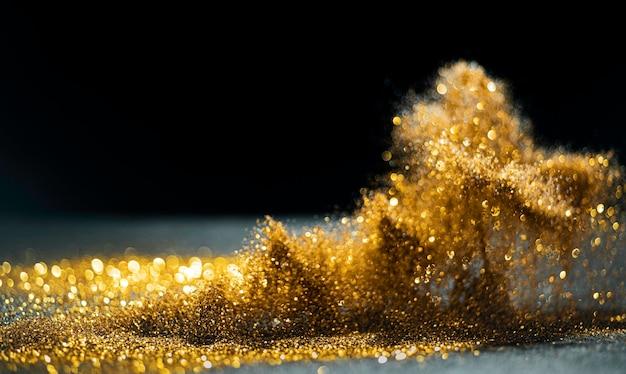 Блеск бомбы гранж, золотой блеск расфокусированным абстрактный фон мерцающие огни.