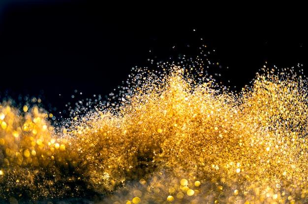 キラキラ爆弾グランジ、ゴールドキラキラデフォーカス抽象的なきらめきライトの背景。