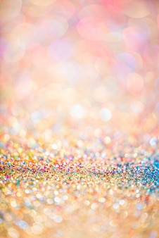 Glitter gold bokeh colorful blurred abstract background for anniversary