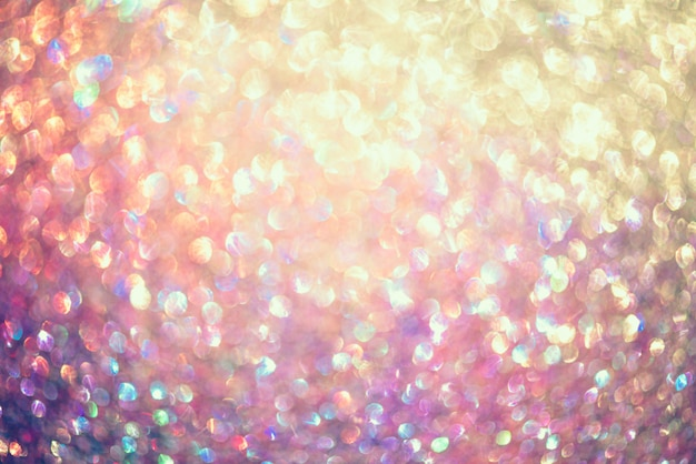 Glitter gold bokeh colorfull blurred abstract background for anniversary