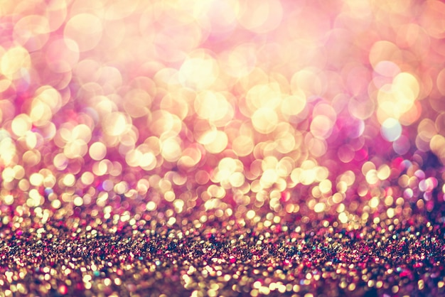 Glitter gold bokeh colorfull blurred abstract background
