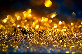 Glitter gold lights grunge background