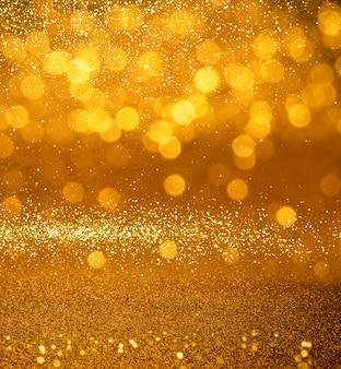 Glitter gold vintage lights texture background. defocused