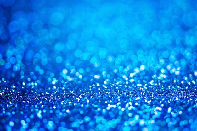 Блеск света абстрактный синий боке светлый фон