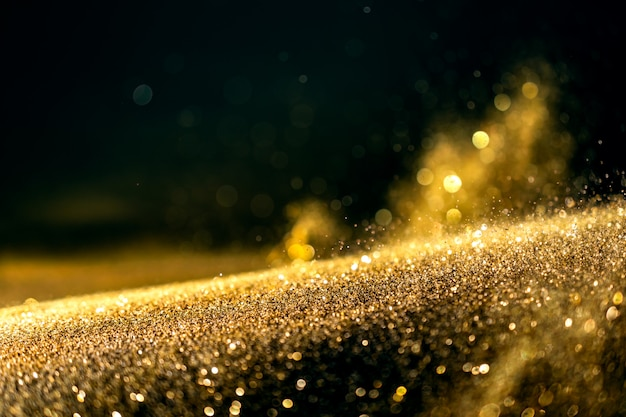 Glitter lights grunge background, gold glitter defocused abstract twinkly lights background.